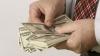 Официальный курс доллара опустился ниже 60 рублей