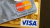 Visa и MasterCard мирятся с ритейлерами за $7 млрд