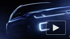 Volkswagen показал тизеры нового роскошного гибридного внедорожника