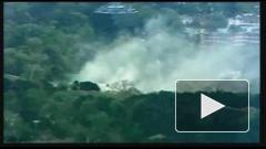 Самолет ВМС США рухнул на жилые дома