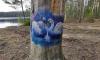 Неизвестный художник расписал деревья в Шуваловском парке: фото