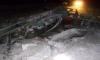 Появились фото КамАЗа с трактором, провалившихся под лед в Томской области