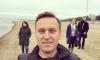 Молодых людей задержали за расклейку афиш Навального на набережной Карповки