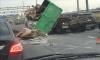 КамАЗ потерял мусорный контейнер на Левашовском шоссе
