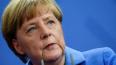 Меркель сравнила объединение России и Крыма с расколом ...