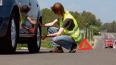 По новым поправкам ПДД водителей обязали носить светоотр...