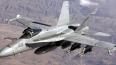 Два боевых истребителя США столкнулись над морем у побер...