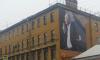 На улице Марата неизвестные развесили на стенах домов огромные баннеры с Путиным