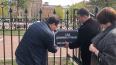 Активисты установили именную табличку на ограду сада ...
