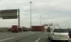 Сорвавшийся с платформы контейнер едва не придавил автомобили на КАД