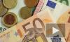 В начале торгов рубль упал по отношению к доллару и евро