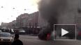 """Горящий """"Кадиллак"""" парализовал движение в центре Петербу..."""