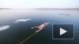 Видео, где дайвер из Чехии плывет под прозрачным льдом о...