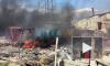 На Лесопарковой горит асфальтоукладчик и строительный мусор