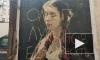 В Петербурге вандалы испортили уличные фрески оскорблениями художников