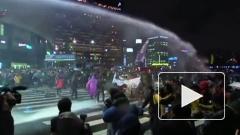 В Сеуле протестующие против торговли с США вышли на улицы