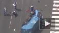 Опубликовано видео из Токио, где мусоровоз после ДТП вле...