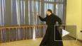 Видео: Ямальский священник станцевал танец с саблями