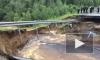 На трассе в Тюмени образовалась яма в 30 метров длиной и 7 в глубину из-за ливней