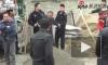 Убийство китайского полицейского мотыгой попало на видео