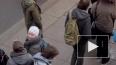 """Активистов """"Марша против ненависти"""" с флагом Украины ..."""