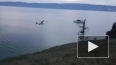 Момент падения самолета в Байкал очевидцы сняли на видео